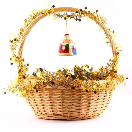 wooden russian santa claus attached to string to the present basket witha a gold garland