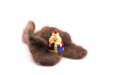 wooden russian santa claus on the cozy downy knitted mitten