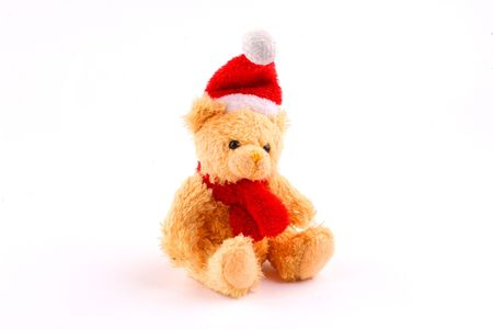 teddy bear in a red santa suit