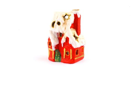 tiny red xmas house with a chimney and snow Stock Photo - 2034736