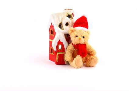 tiny santa teddy bear and red house with chimney and snow