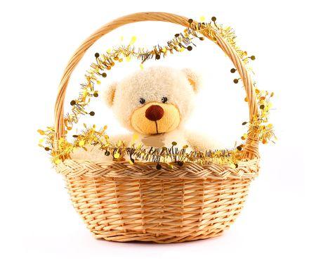 fluffy white teddy bear in a basket witn gold garland