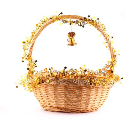 little golden bell attached to string to present basket with gold garland Stock Photo