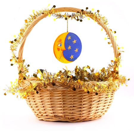wooden moon attached to string to the present basket witha a gold garland Stock Photo