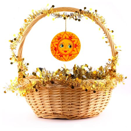 wooden sunny attached to string to the present basket with a gold garland