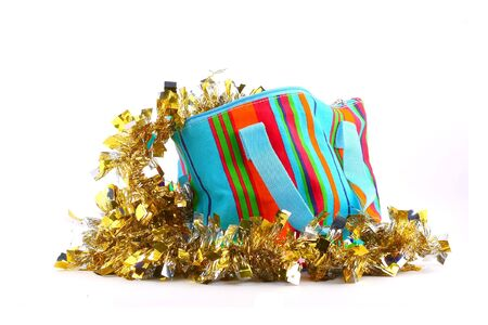 small multicolored bag with gold garland Stock Photo