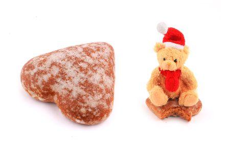 Santa teddy bear on bitten cake and big cake