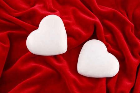couple of shugar gingerbread hearts over purple velvet Stock Photo - 2159780
