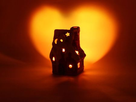 shining heart from a warm tiny candle-house