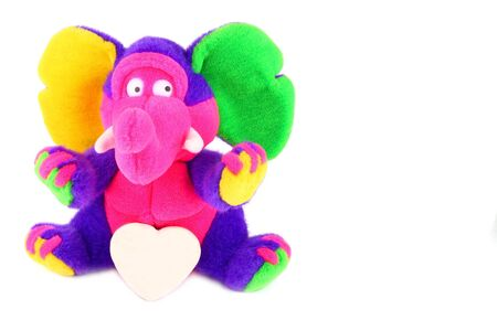 multicolored fluffy elephant with a white shugar heart over white Stock Photo