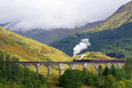 The Jacobite steam train on Glenfinnan Viaduct. Scottish Highlands
