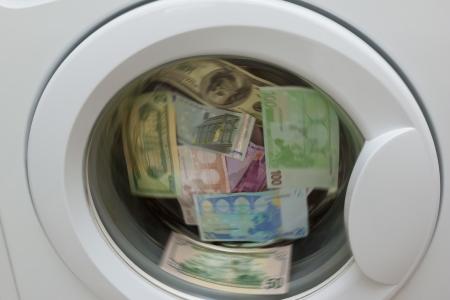 money laundering: money laundering in washing machine Stock Photo