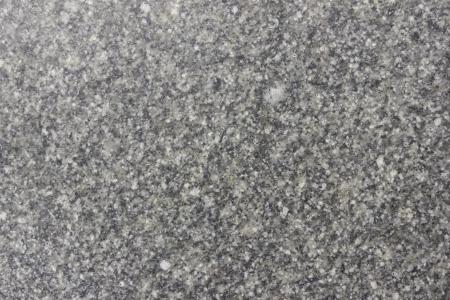 Seamless black granite texture  Close-up photo photo