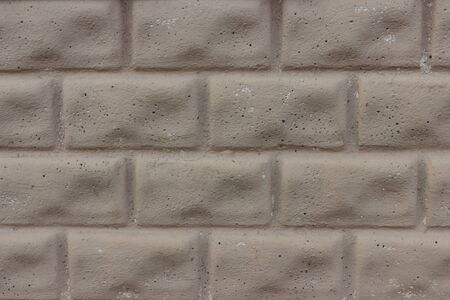 Concrete fence - simulation of brick wall photo
