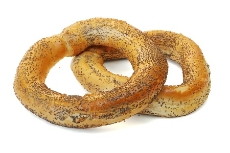 baranka: Bagels covered with poppy seeds on white background