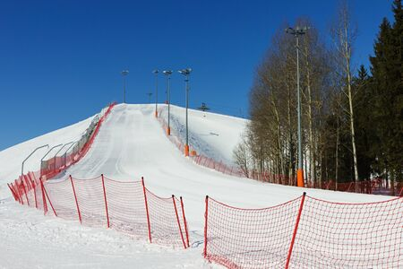 View of the ski slope on winter sunny day  photo