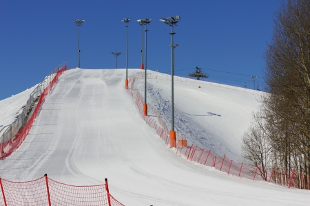 View from the bottom of the ski slope on a sunny day  photo