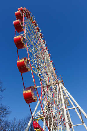 Ferris wheel with red-yellow cabins  photo