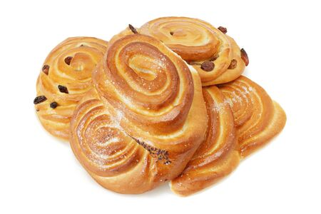 Four sweet buns with cinnamon  and raisins isolated on white background  photo