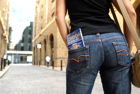 buttom: Tourist Girl with London map in her buttom pocket