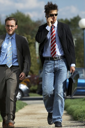 Two young partners are heading up to a meeting Stock Photo