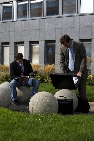 enyoing: Two business men enyoing there break outside the office Stock Photo