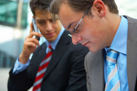 Two young business men looking concerned  Stock Photo