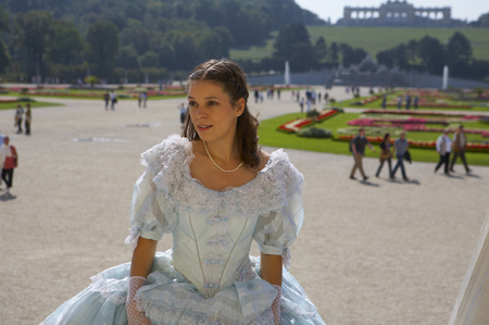 a young female dressed like the austrian Empress Elisabeth in fine monarchy syle