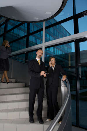 Three business people standing on stairs Stock Photo - 1726167