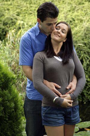 Kissing couple in garden photo