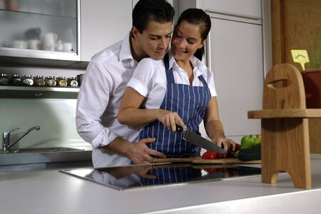 Young attractive couple making dinner
