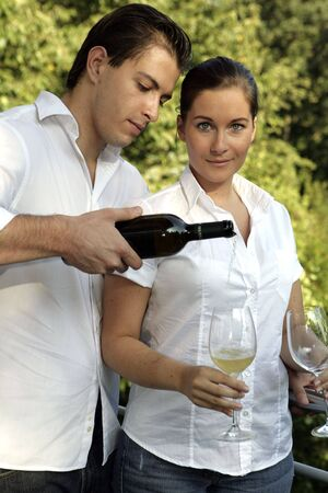 attractive couple having a glas of wine