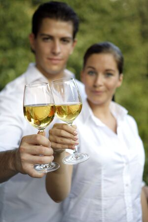 Young couple with glas of wine