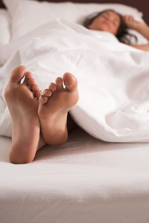 Bright Closeup of woman´s feet in bed photo