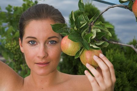 Young attractive Woman with apple in her hand
