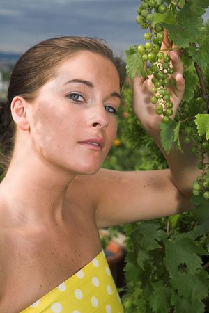 Young attractive Woman with grapes in her hand Stock Photo