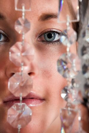 Young attractive Woman eyes closeup with glitter chain Stock Photo