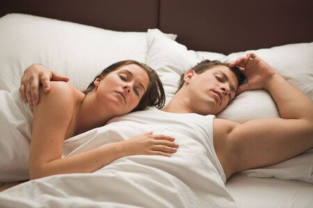 Young attractive couple sleeping in the mornig