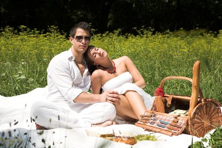 Young attractive couple having a picknick in the sun Stock Photo