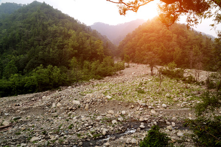 Elevated view of dried river in mountain range.