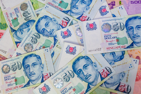 affluence: Singapore Dollar, Banknote Singapore and Thai Baht in the Corner, The Singapore dollar is the official currency of Singapore Stock Photo