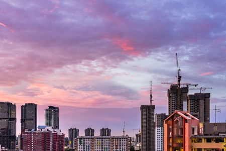 View of Construction site in Downtown Singapore skyline with twilight purple clouds