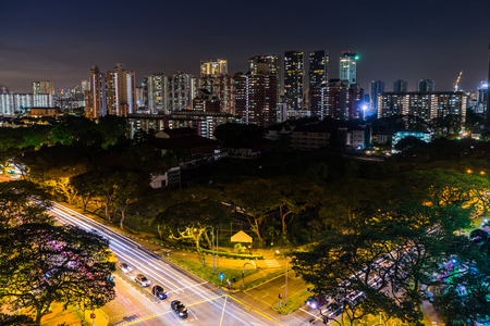 View of the Downtown Singapore skyline, night scene long exposure with traffic and car trails
