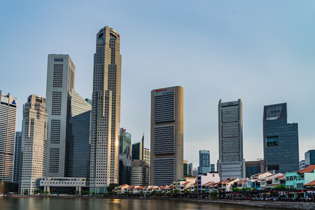Singapore - April 29, 2017: Boat Quay, a historical district in Singapore and Financial building in background