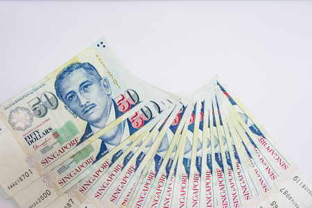 Singapore Dollar, Banknote Singapore on White background, The Singapore dollar is the official currency of Singapore
