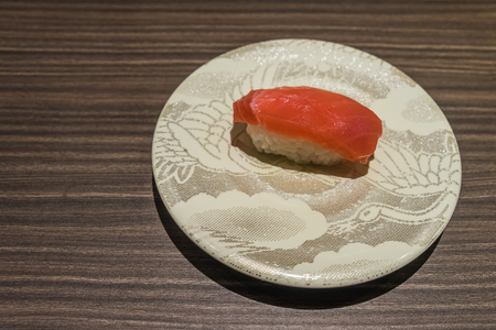maguro: Otoro Tuna sushi, Japanese food raw fish on top of rice in white dish on wooden table