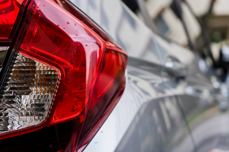 Focus closeup of Car rear light, Detail of modern car rear lamp grey color