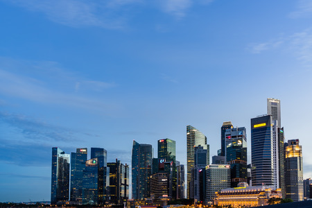 Singapore - August 1, 2017: Singapore skyline dusk and illuminated financial district night view, Downtown Urban cityscape of Singapore. Modern skyscrapers of business district Marina Bay Publikacyjne