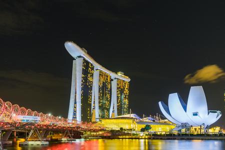 Singapore - August 1, 2017: Night scene of Marina Bay Sands Hotel and The Lotus Shaped ArtScience Museum with illuminated lighting