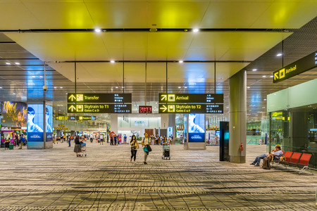Singapore - July 16, 2017: Visitors walk around Departure Hall in Changi Airport. It has 4 passenger terminals, and is one of the largest transportation hubs in Asia